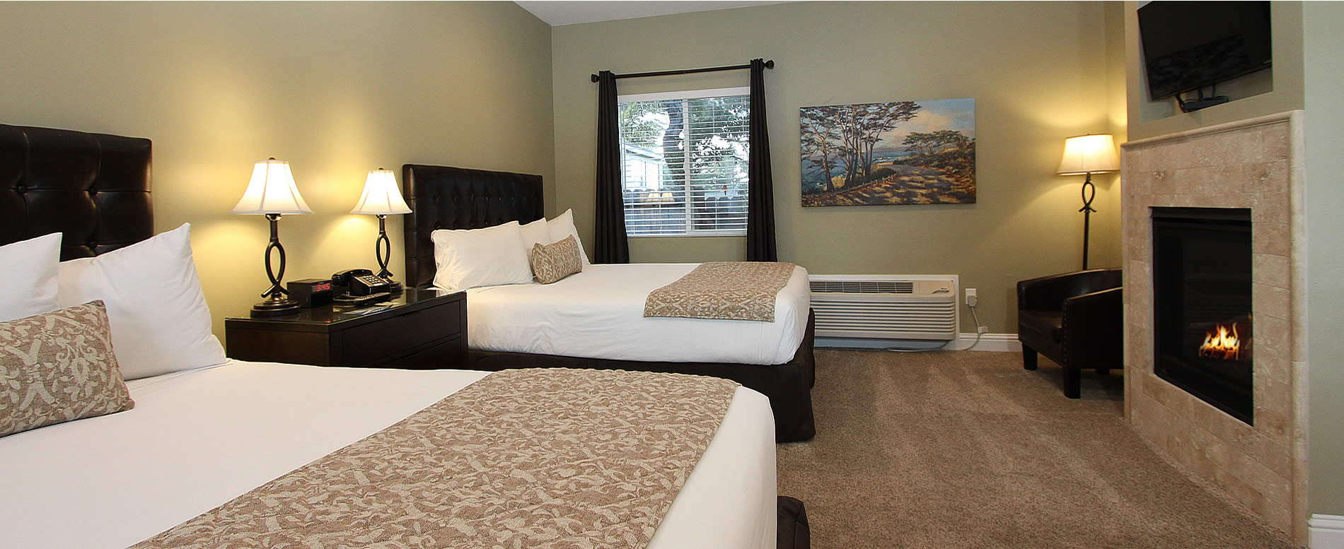 monterey ca lodging - two beds, fireplace and TV