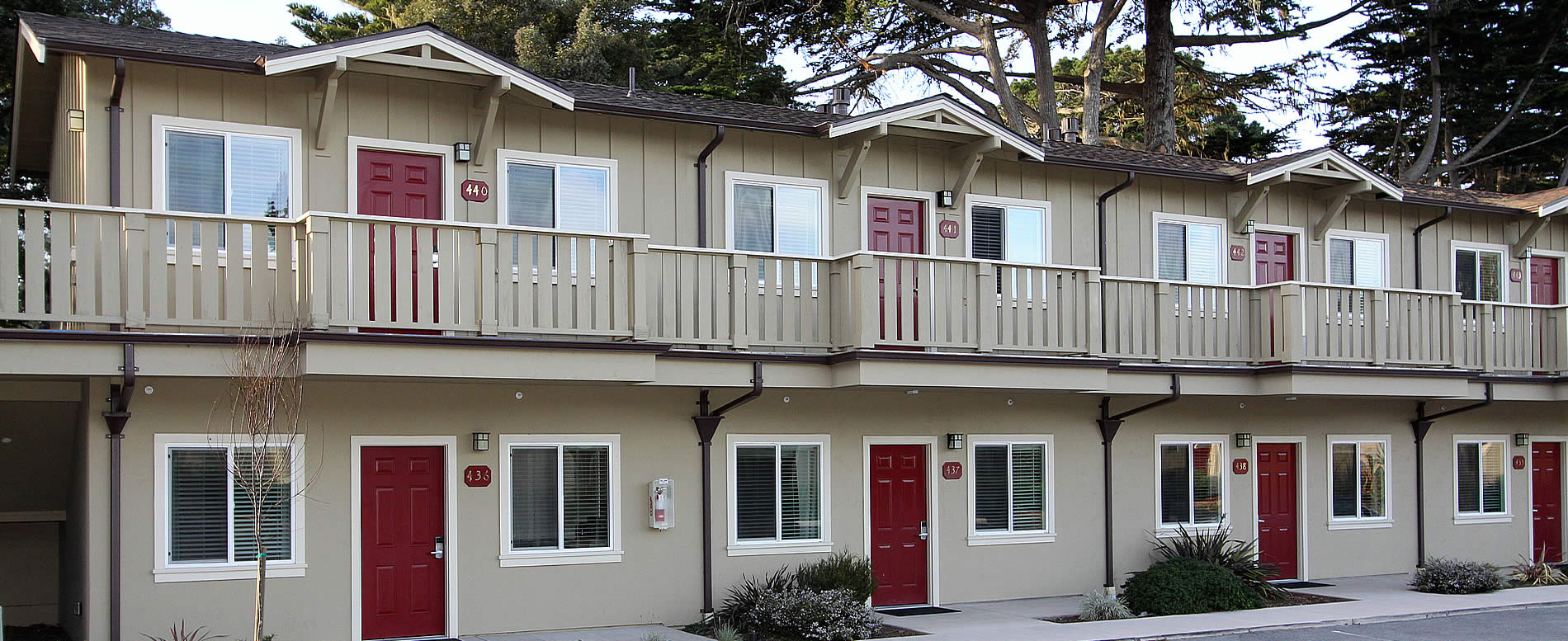 Pacific Grove Hotel - exterior with burgundy doors